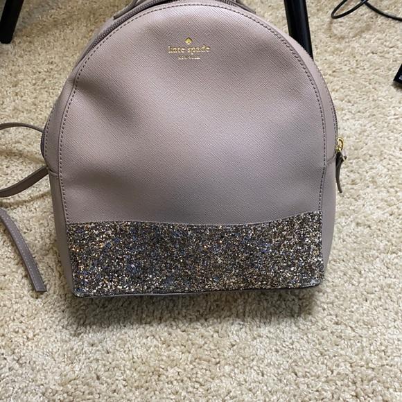 Medium size Kate Spade backpack purse.